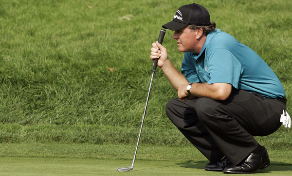 Phil Mickelson failed to make several short putts on the back nine, and he finished at five under.