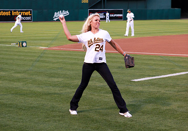 Natalie Gulbis warmed up before throwing out the first pitch at a Rangers/A's game in September 2009.