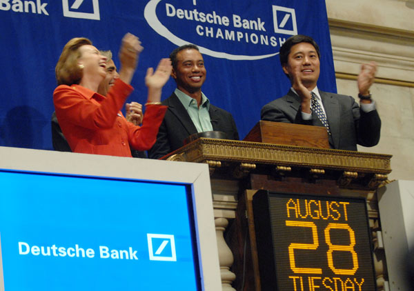 Woods, second from right, was joined by Deutsche Bank Americas CEO Seth Waugh, second from left, New York Stock Exchange president and co-COO Catherine Kinney, left, and NYSE CFO Nelson Chai as he rang the opening bell at the New York Stock Exchange.
