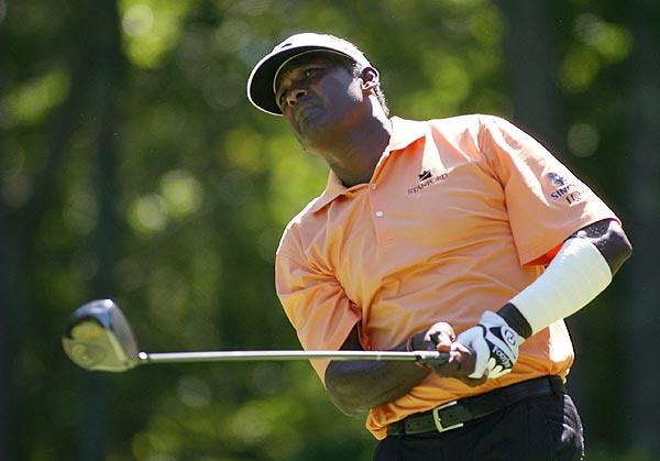 Vijay Singh is at 14 under par.