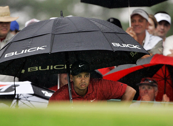 Despite rainy conditions, Tiger Woods shot a final-round 65.