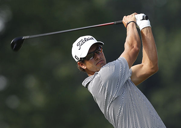 Adam Scott made four birdies on the back nine to grab a one-shot lead heading into the final round.