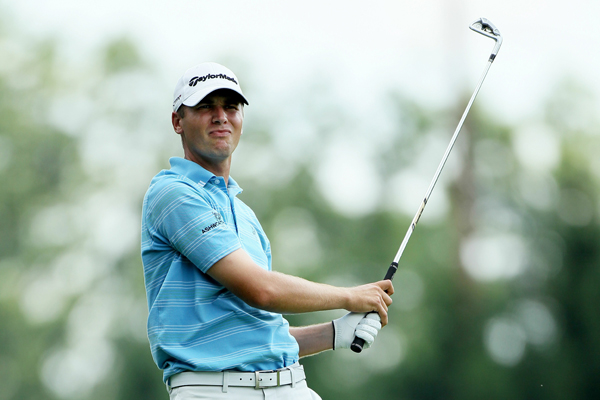shot a 6-under 64 to tie Ryan Palmer for the 54-hole lead.