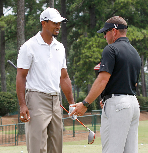 Woods worked with swing coach Sean Foley on the range before Foley followed him on the course.