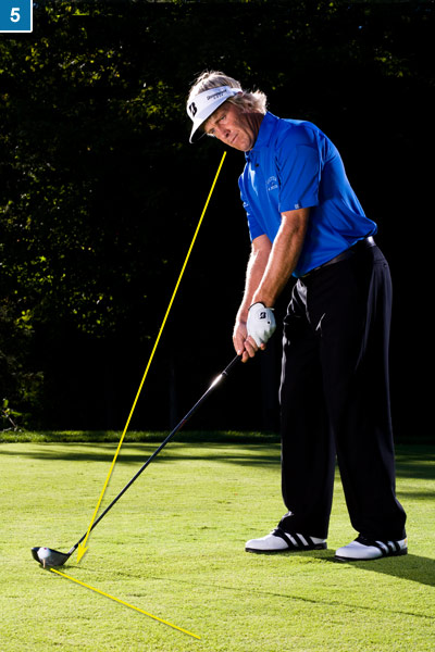5. Set your clubhead behind the ball and point the face down the line. Your focus still hasn't moved from the line in front of the ball.