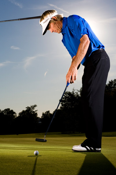 My Contact Drill                                                      Get into your putting stance and have a friend hold the butt of any club against your head at the hairline (or where it used to be!). Make sure the grip just barely touches and then stroke the putt. If you're like most golfers, your head will either move into or away from the grip. You can't make a level strike this way. The ball will hop instead of roll and you'll come up short. Practice until you can maintain contact from start to finish.                                                      Stuart Appleby is playing his 13th season on Tour. His tournament earnings of $22 million place him 12th on the career money list.