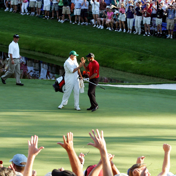 Sweet 16                                              If you want to catch the action at Amen Corner your best bet is on T V. But if you want to get close, get comfortable, be near the cheap sandwiches and see                       some of the most decisive and heroic shots, the 16th green is the place to be once you set foot on Big Green. Think Jack in '75 and '86, and Tiger in '05, and brother, pass me a cold one.                       Tiger and caddie celebrate his famous chip on No. 16 in 2005.