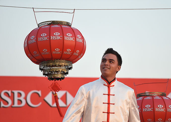 Rickie Fowler hangs a Chinese lantern at the Peninsula Hotel prior to the start of the HSBC Champions on Nov. 4, 2014, in Shanghai, China.