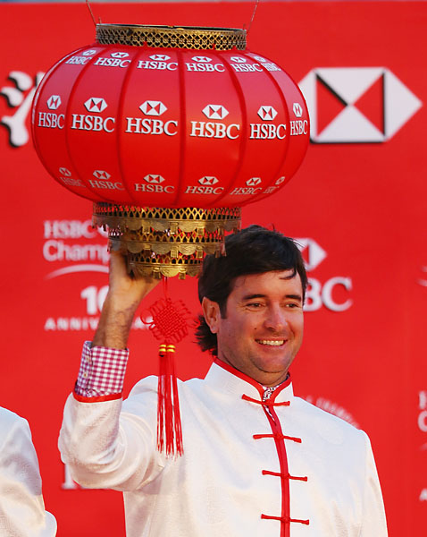 Bubba Watson is a long way from Waffle House. Here he hangs a Chinese lantern at the Peninsula Hotel in China.