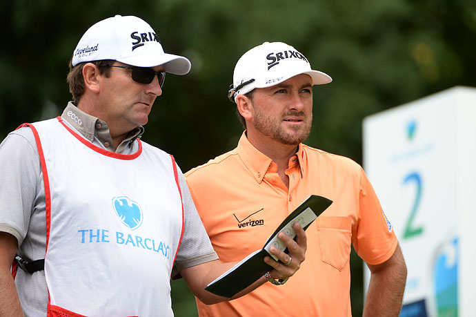 Graeme McDowell  and his caddie Ken Comboy stand on the second tee during the third round of the Barclays at the Ridgewood Country Club on Saturday.