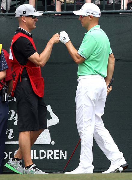 Ben Crane fist-bumps his caddie Joel Stock on the first hole. Crane got his first top 10 finish of the year in Houston.