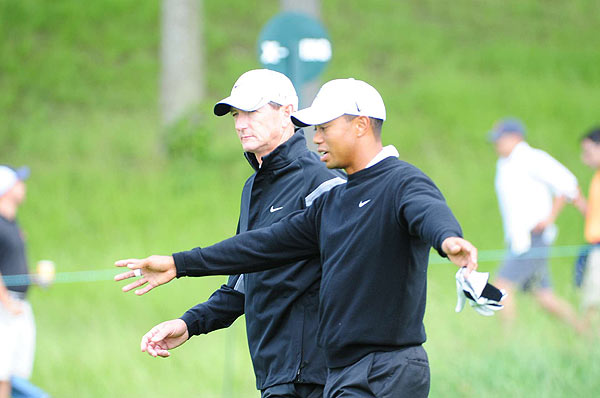 Swing coach Hank Haney strolled the course with Woods.