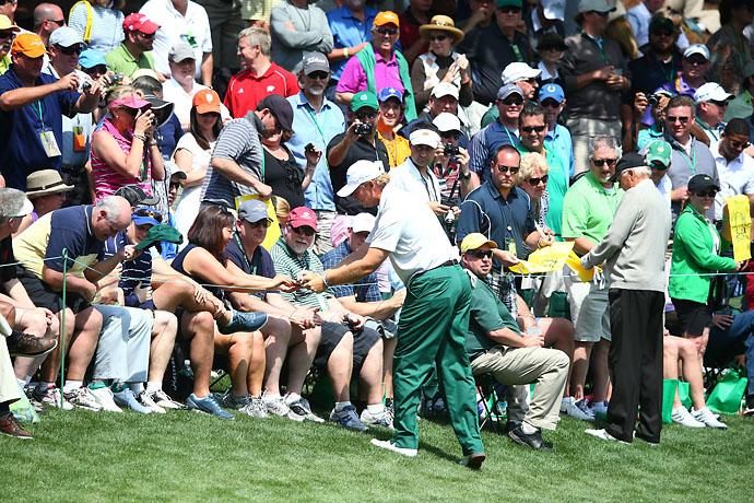 Ernie Els greets fans at the Par 3 Contest.