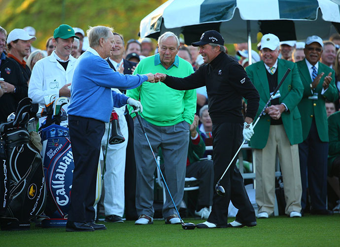 Jack Nicklaus, Arnold Palmer and Gary Player gather for the ceremonial opening round tee shot. The former champions all found the fairway.