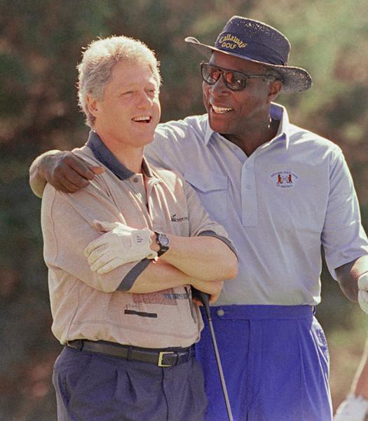 Clinton with adviser Vernon Jordan at Farm Neck Golf Club in August of 1993.