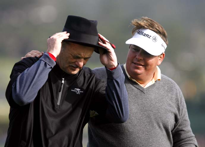 Bill Murray and Tim Herron walk off the 18th hole at Pebble Beach Golf Course during the third round of the AT&T Pebble Beach National Pro-Am on February 14, 2009