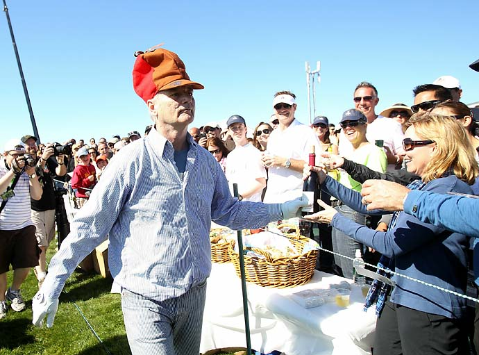 Bill Murray hands out bottles of wine to fans during the third round of the 2011 AT&T Pebble Beach National Pro-Am at Pebble Beach Golf Links.