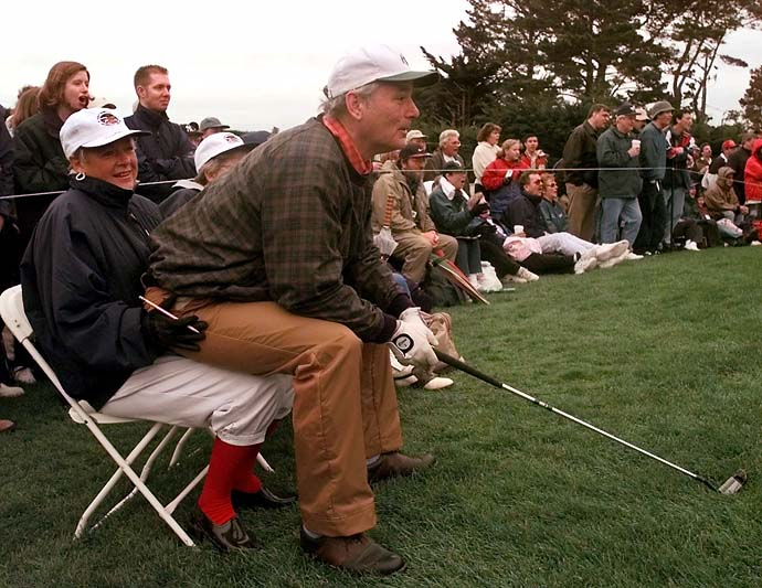 Bill Murray sits on the lap of scorekeeper Marta Rash of Alamo, Calif., at greenside of the third hole at Pebble Beach Golf Links during third round action at the 1999 AT&T Pebble Beach National Pro-Am.
