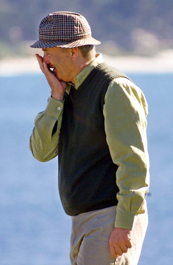 Bill Murray covers his face after missing a putt on the 18th green of the Pebble Beach Golf Links during the 3M Celebrity Challenge event of the AT&T Pebble Beach National Pro-Am in Pebble Beach, Calif., in January 2002.