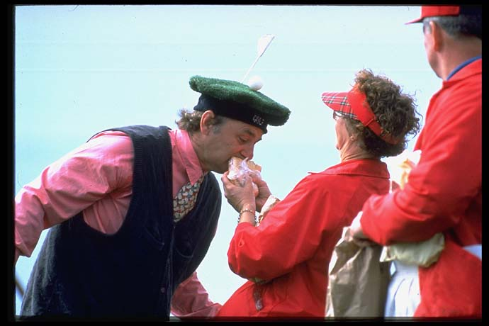 Bill eats a fan's sandwich at the 1995 Pebble Beach National Pro-Am.