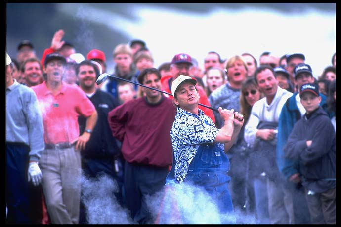Bill Murray hits an exploding golf ball in front of fans at the Pebble Beach National Pro-Am in February 1996.