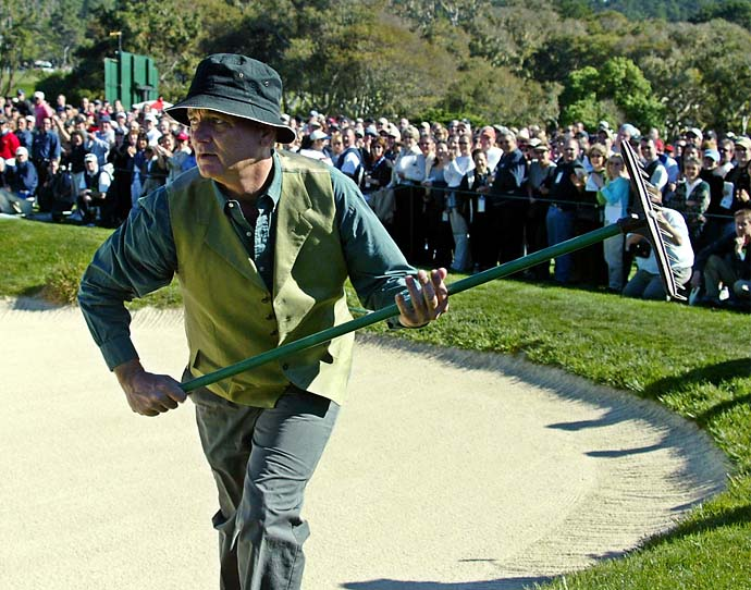Bill Murray runs out of a bunker with a rake after chipping his ball up to the third green of the Pebble Beach Golf Links during 3rd round play of the 2003 AT&T Pebble Beach National Pro-Am.
