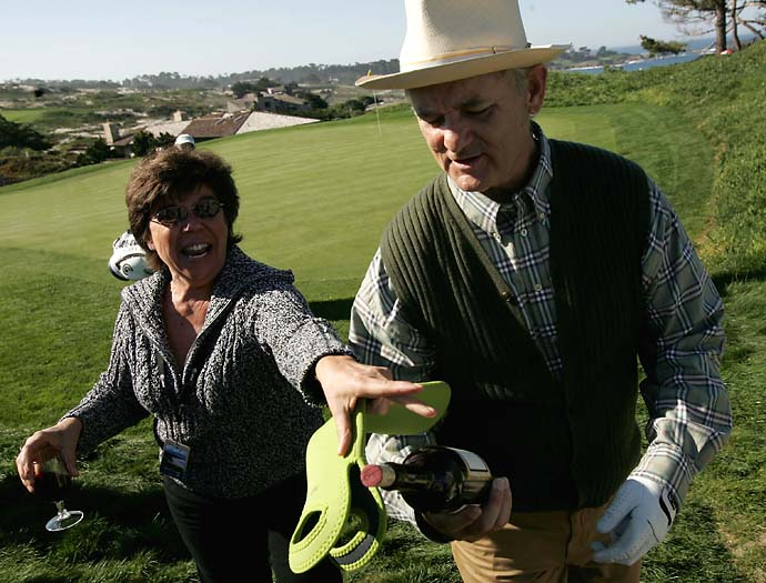 Norma Glaser of Concord, Calif., tries to retrieve her bottle of wine from Bill Murray during the first round of the 2005 AT&T Pebble Beach National Pro-Am at Spyglass Hill Golf Course.