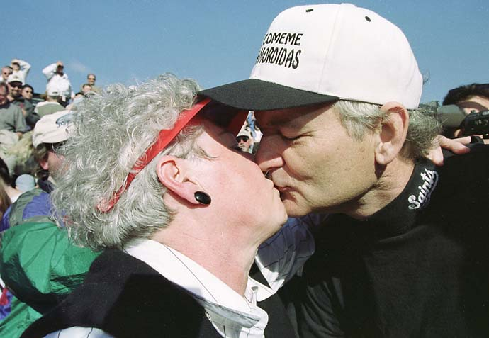 Bill Murray kisses and makes up with golf fan Fran East, 59, of Fairfield, Calif., after he tossed her into the bunker on the 18th hole during the Celebrity Challenge the day before the AT&T Pebble Beach National Pro-Am at Pebble Beach Golf Links.