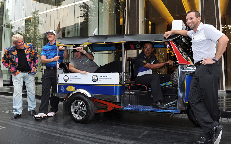 From left to right: John Daly, Hunter Mahan, Bubba Watson, Thongchai Jaidee and Sergio Garcia posed with a tuk tuk at the 2012 Thailand Golf Championship.
