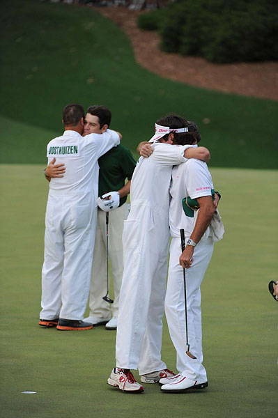 Watson and Oosthuizen with their caddies after it was all over.