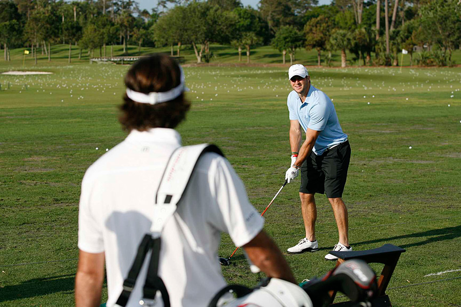 Bubba Watson gave Jets quarterback Tim Tebow a few tips before heading out for Tebow's golf outing at TPC Sawgrass.