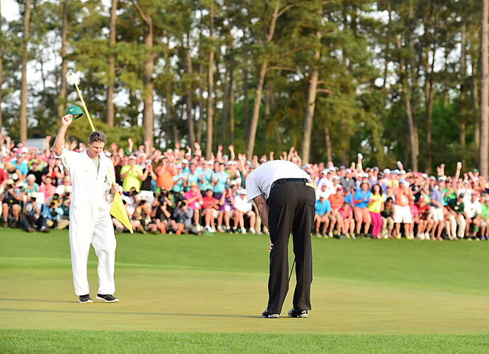 Watson bent over in relief after tapping in the winning putt on the 18th green.