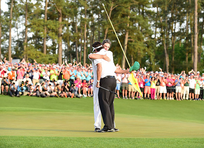Bubba Watson embraces his caddie following his victory at the 2014 Masters.