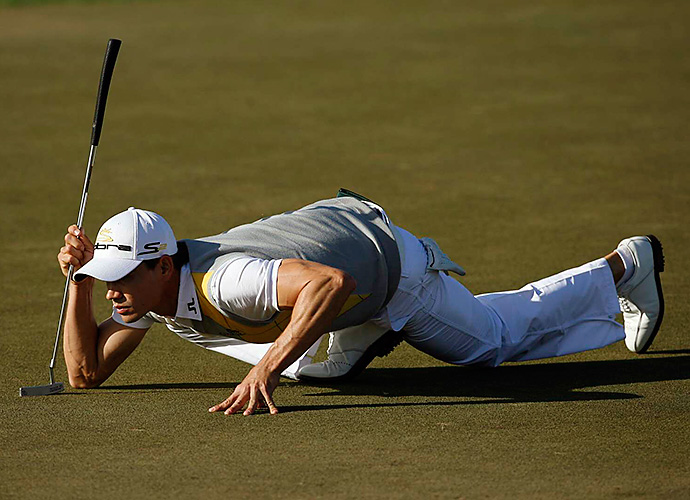 "Camilo Villegas lines up a putt in the final round of his 2010 Honda Classic win. Villegas won by five shots, despite struggling on the back nine. ""Those finishing holes are tough,"" said Villegas."