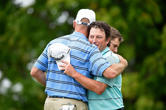 Jim Furyk congratulates Tim Clark of South Africa during the final round of the RBC Canadian Open at the Royal Montreal Golf Club on Sunday. Clark beat Furyk by a stroke.