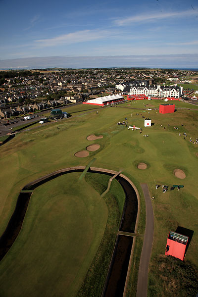 16. 18th at Carnoustie -- Par 4, 444 yards -- Carnoustie, Scotland                       You don't have to be an ill-fated Frenchman to feel the full force of this exacting finisher, which forces you to fly the Barry Burn not once, but twice, the first time with out-of-bounds awaiting on the left. When the wind is up, as it often is, four is a heroic score here. Five beats Jean Van de Velde by two.