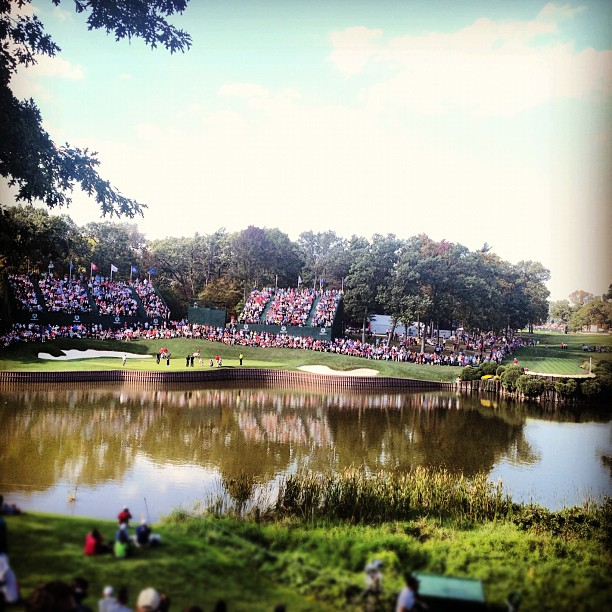 @stephaniemwei:View of the 17th green and 18th tee from the hill across the pond.