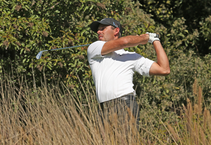 Charl Schwartzel birdied two of the last three holes to finish three shots off the lead.