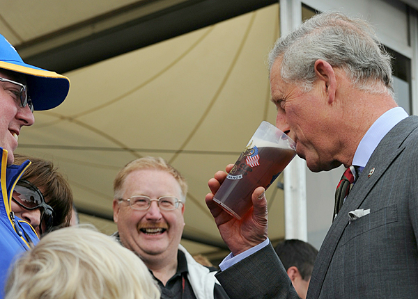 Before he left, Prince Charles took a swig of a fan's beer.