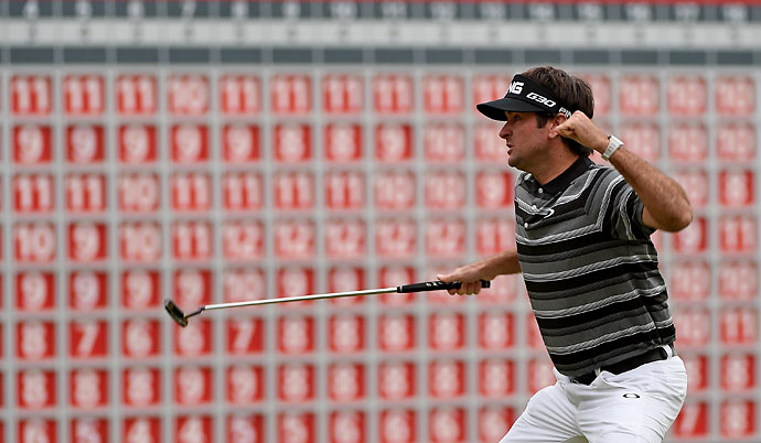 Bubba Watson celebrates his birdie putt and victory on the first playoff hole during the final round of the WGC-HSBC Champions in Shanghai.