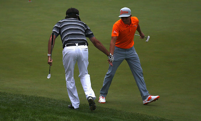 Bubba Watson celebrates with Rickie Fowler, after chipping in from the bunker on the 18th Hole to make a play-off during the final round of the WGC-HSBC Champions at the Sheshan International Golf Club on Nov. 9, 2014, in Shanghai, China.