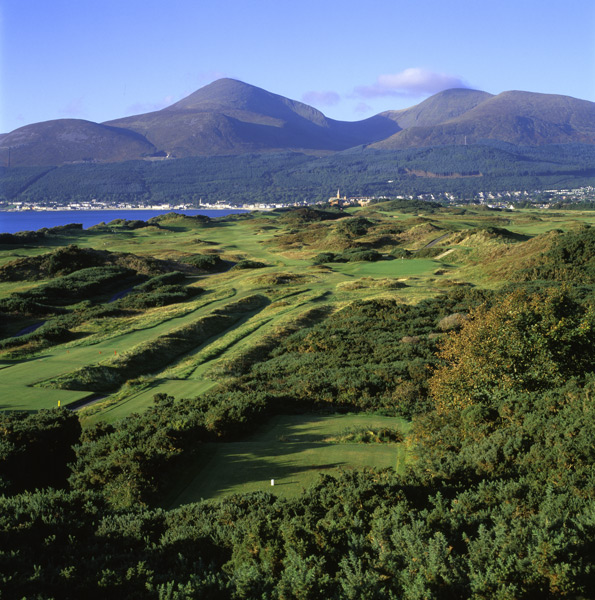 Royal County Down Golf Club -- Newcastle, Co. Down, Northern Ireland -- No. 4: Par 3, 228 yards                       After seeing a photo in the early 1980s of this stunning one-shotter, I vowed that one day I would experience that unforgettable panorama. In May 1996, I checked it off from my golf bucket list, the hole having lived up to every expectation. From the elevated back tee, you're greeted by a sea of gorse, bursting brilliant yellow in spring, nine bunkers, mountain peaks and a hotel spire -- with the sea and its pesky breezes looming to the left.