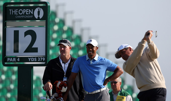 Woods played his practice round with Fred Couples and Jason Dufner.