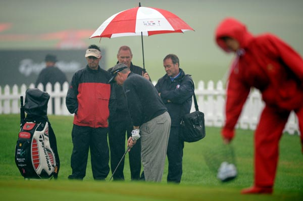 Friday Washed Out                       Heavy rain wiped out round 2 of the HSBC Champions on Friday. Darren Clarke of Northern Ireland practiced despite the weather.
