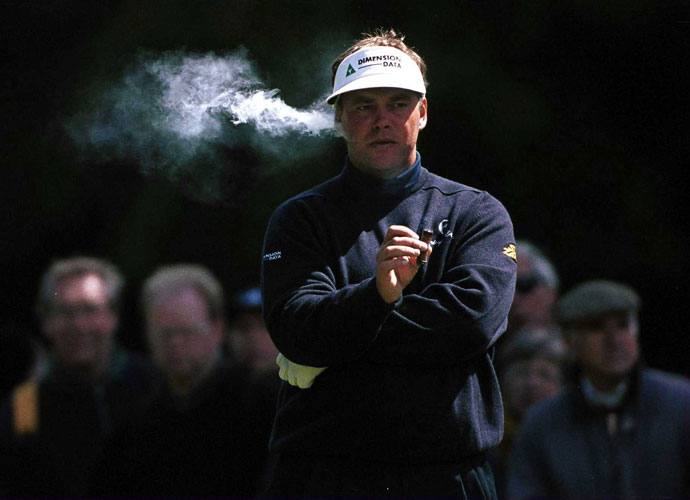 Darren Clarke takes a break from the second round of the 2000 Volvo PGA Championships to enjoy a cigar on the third hole. Clarke (-14) finished second to Colin Montgomerie's -17.