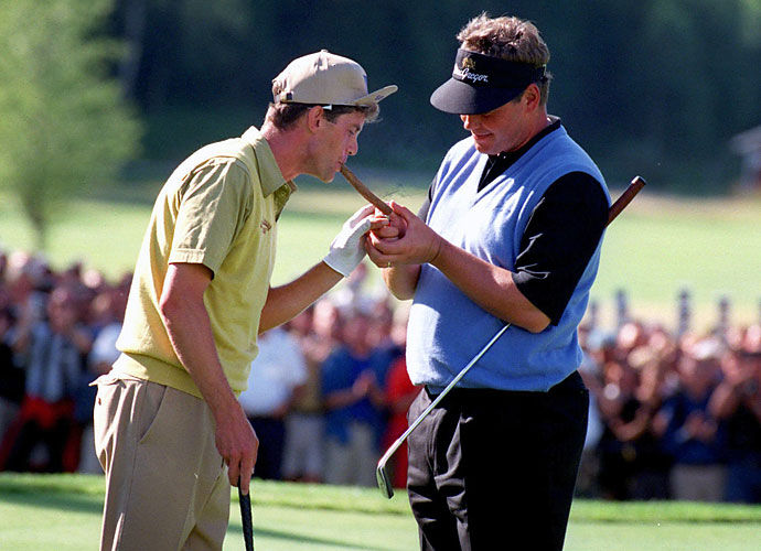 A helpful Darren Clarke (right) assists Jesper Parnevik with his cigar following the final round of the 1998 Scandinavian Masters in Stockholm. Parnevik won the event for the second time in four years, three strokes ahead of Clarke.