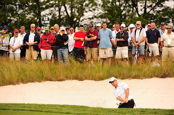 Duval opened Monday with a triple bogey on the par-3 third, where his ball plugged under the lip of the bunker.