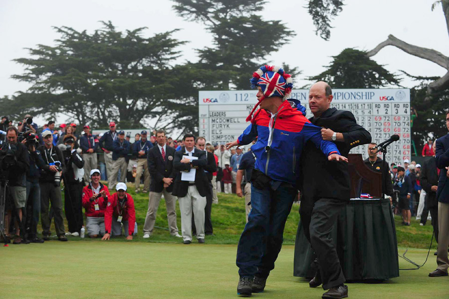 During the award ceremony, USGA Executive Director Mike Davis hauled off a heckler who interrupted the proceedings on the 18th green.