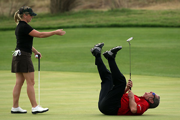 Father-Son Challenge: Round 1                                                      Fuzzy Zoeller reacted to a close miss for birdie by falling over. His daughter Gretchen Zoeller helped him up.