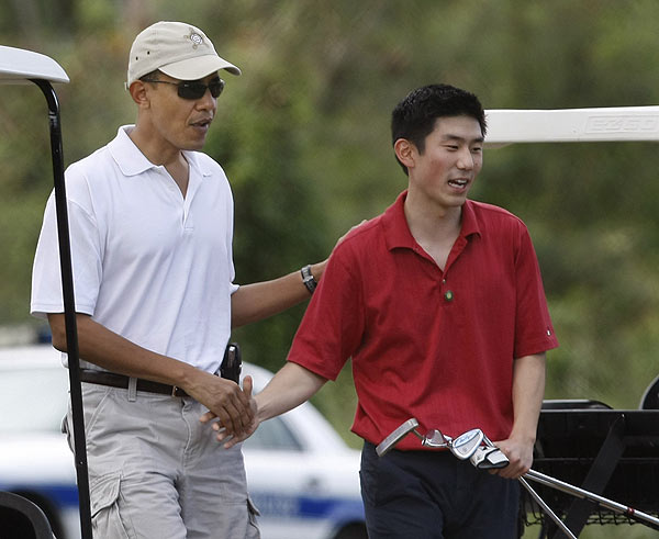 Obama golfed with one of his staff members, Eugene Kang.